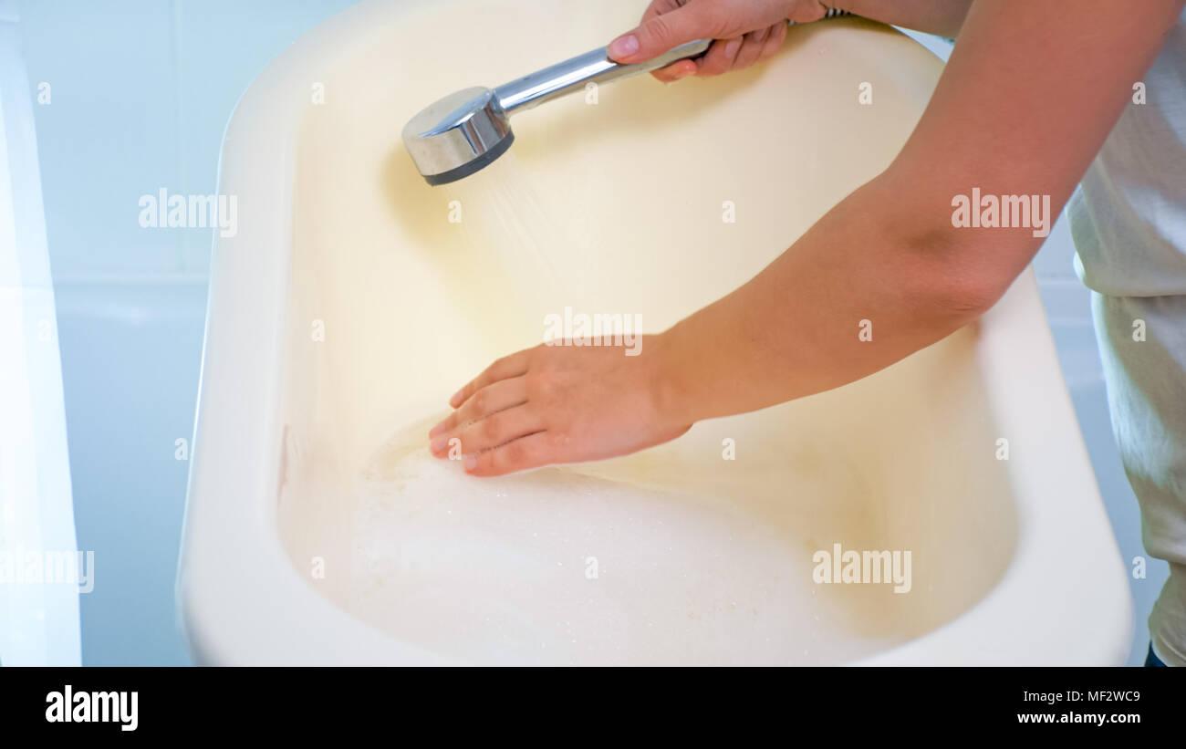 Young Woman Touching Water Bathtub Stock Photos & Young Woman ...