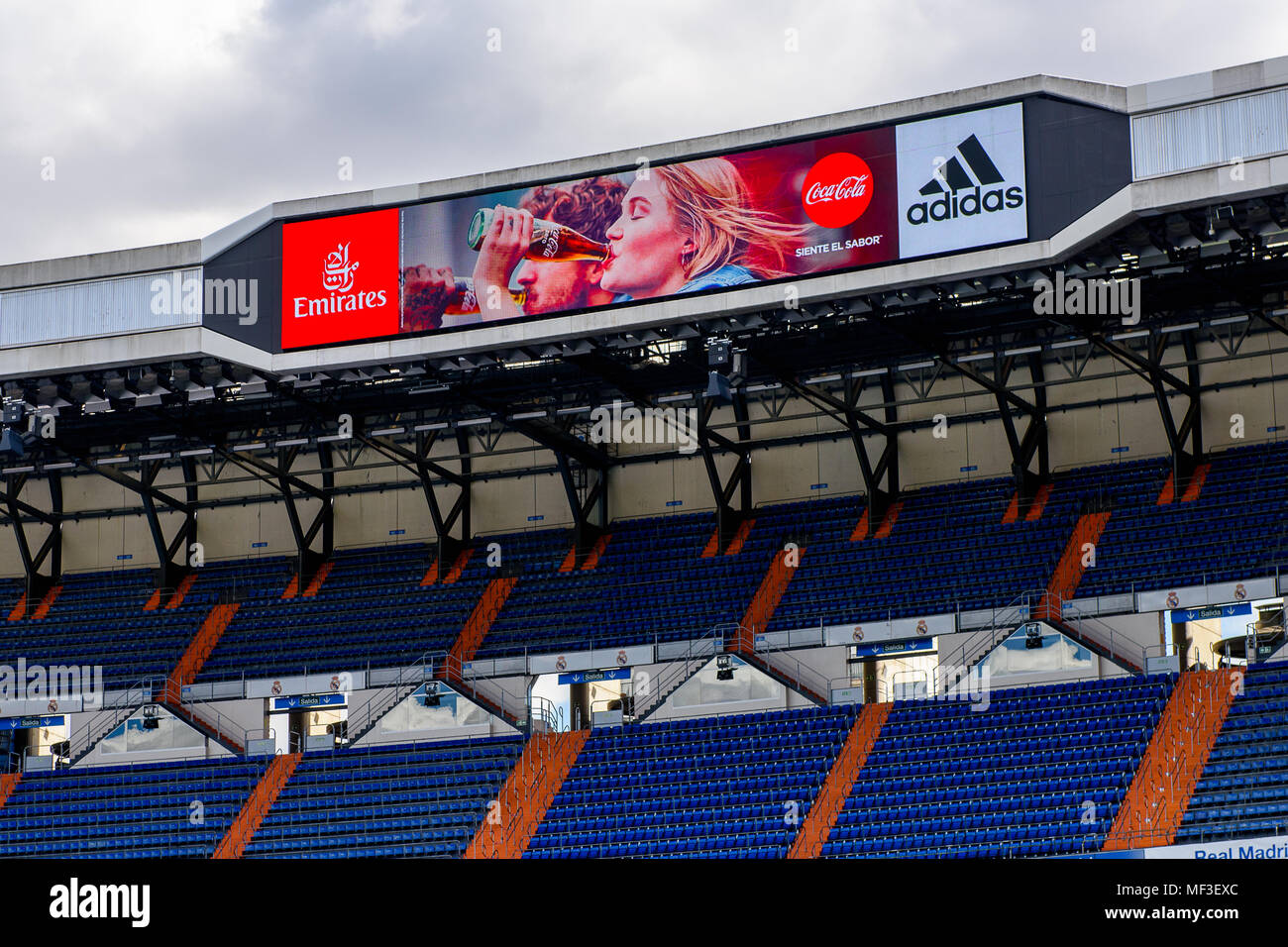 Deslumbrante Marchito Dinkarville  MADRID - APRIL 14, 2018: Emirates, Coca Cola, Adidas logos on the screen of  the Santiago Bernabeu stadium, the home arean of the football club Real Ma  Stock Photo - Alamy