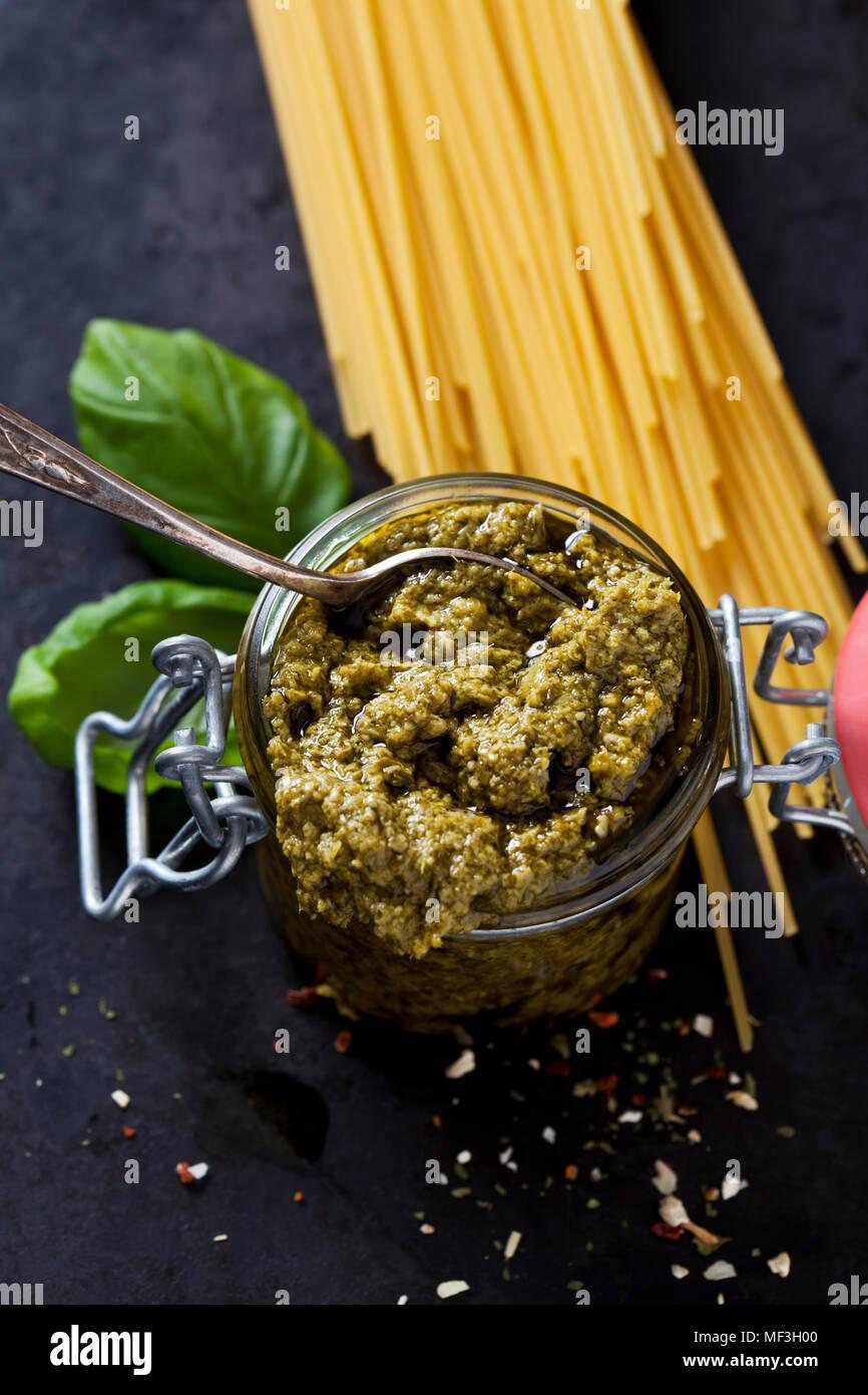 Preserving jar of basil pesto - Stock Image