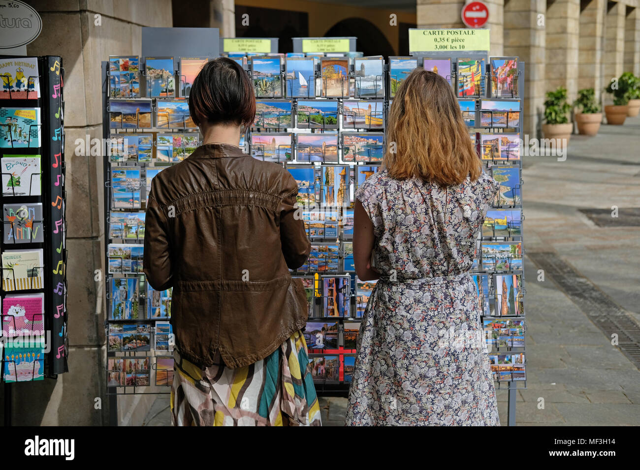 Buying postcards in France - Stock Image