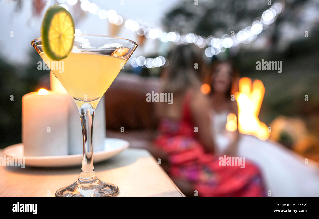Close-up of lime cocktail ready to drink at an outdoor party - Stock Image