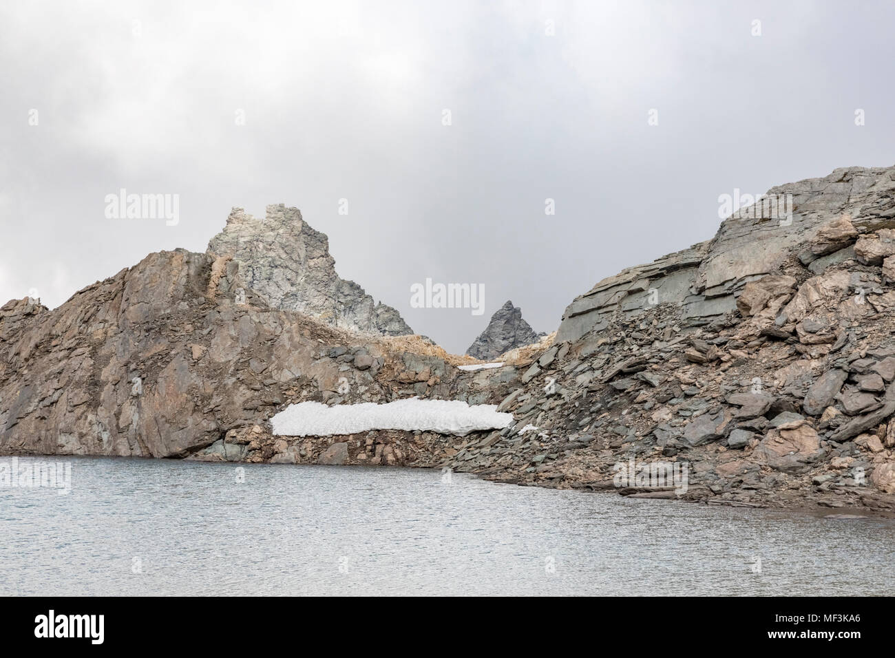Italy, Piemont, Colle Sommeiller, Mountain lake - Stock Image