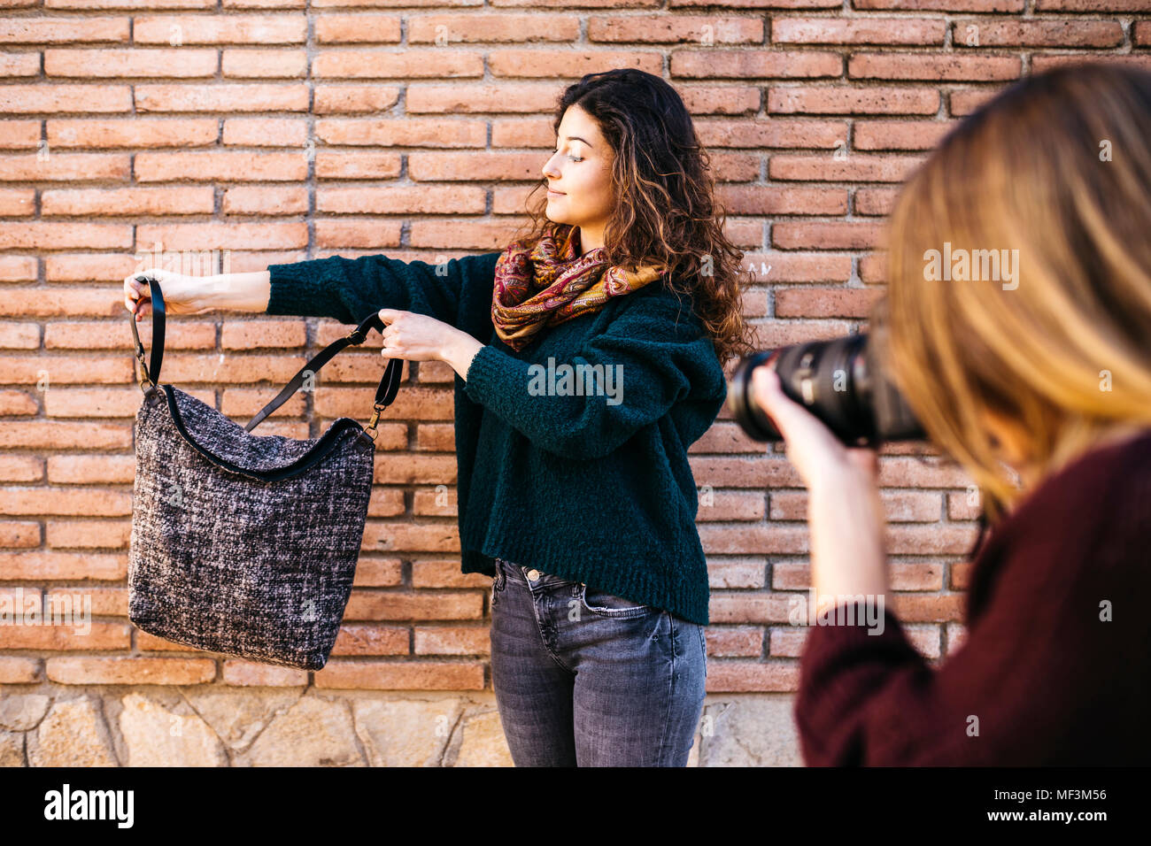 Fashion designers doing a photo shoot of their new products Stock Photo