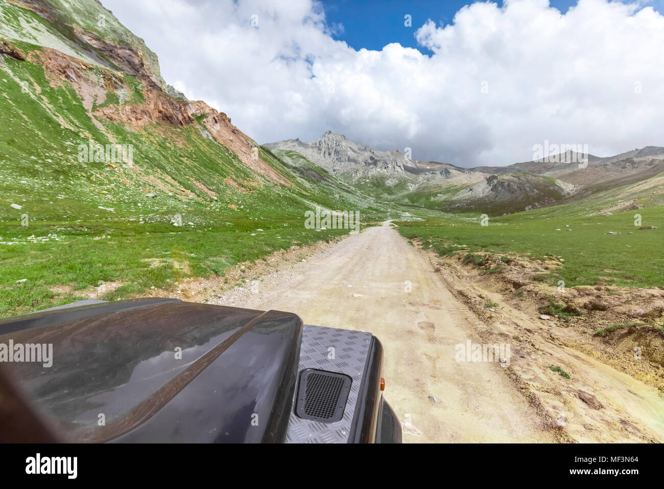 Italy, Piemont, Landrover on rural road Stock Photo