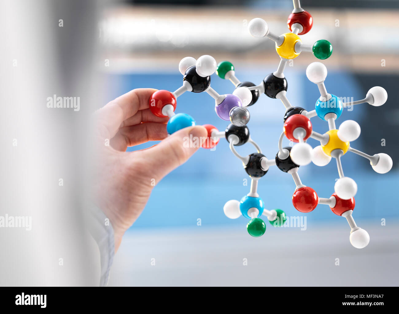 Scientist holding a molecular model - Stock Image