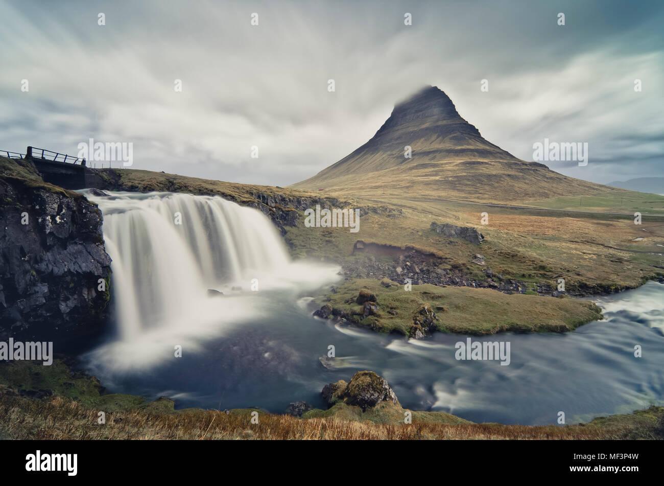 Iceland, Kirkjufellsfoss waterfall and Kirkjufell in the background - Stock Image