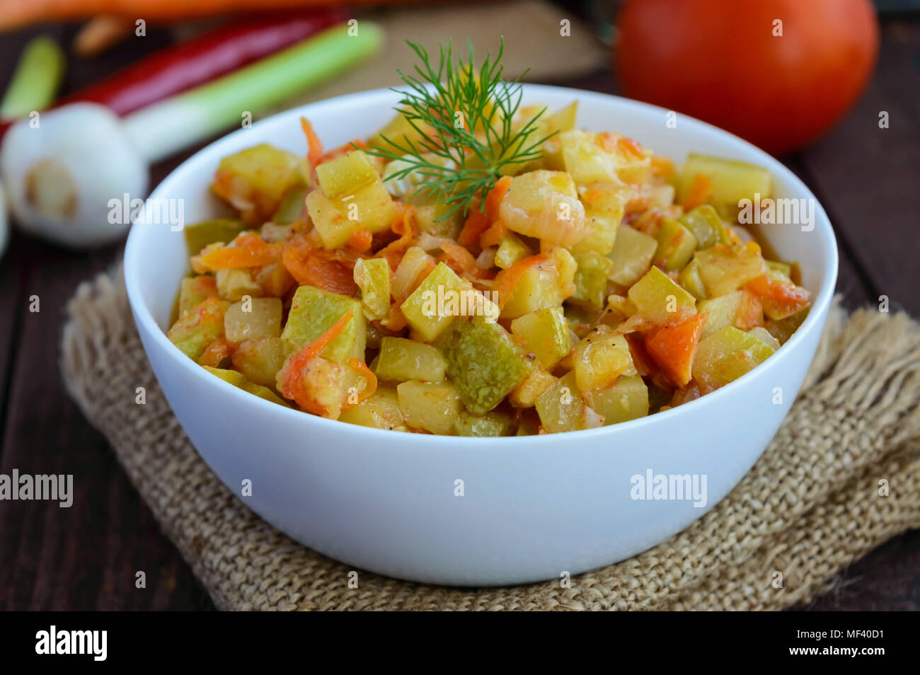 Ragout from zucchini, carrots and tomatoes. Recipes of vegetable stew