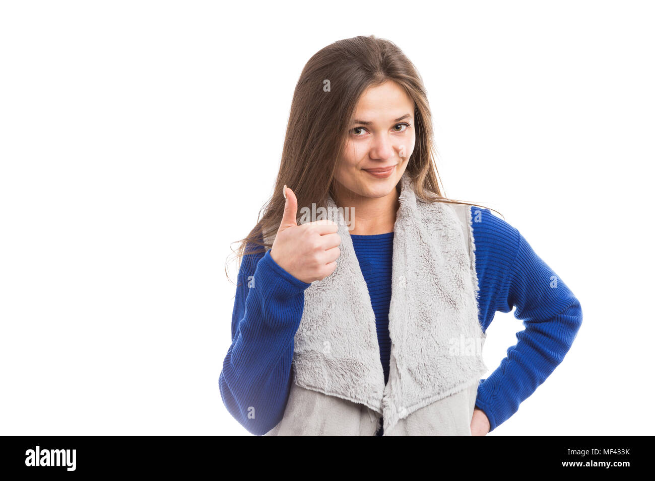 Attractive young woman wearing sweater and vest showing ok gesture and smiling isolated on white background - Stock Image