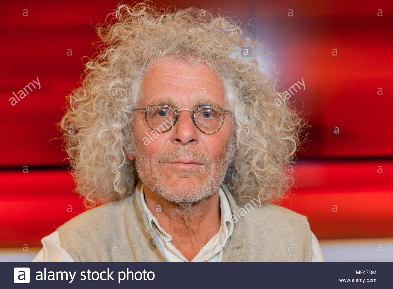 Rainer Langhans, 68er Ikone im Fernsehstudio bei Hart aber fair im Studio Adlershof in Berlin. Portrait des ehemaligen Kommunarden. - Stock Image