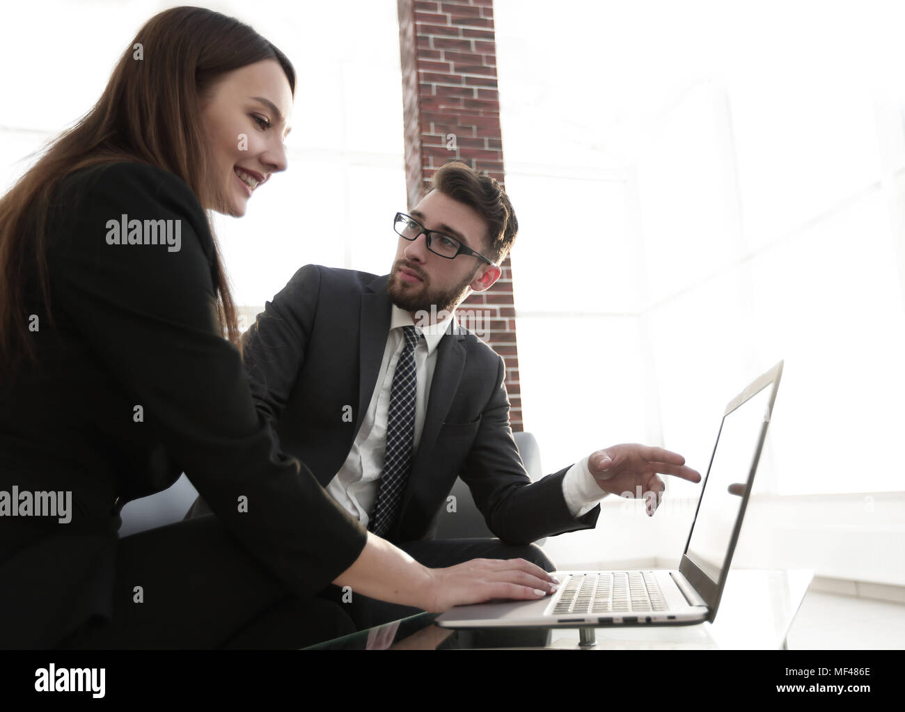 Couple of young designers working at modern office - Stock Image