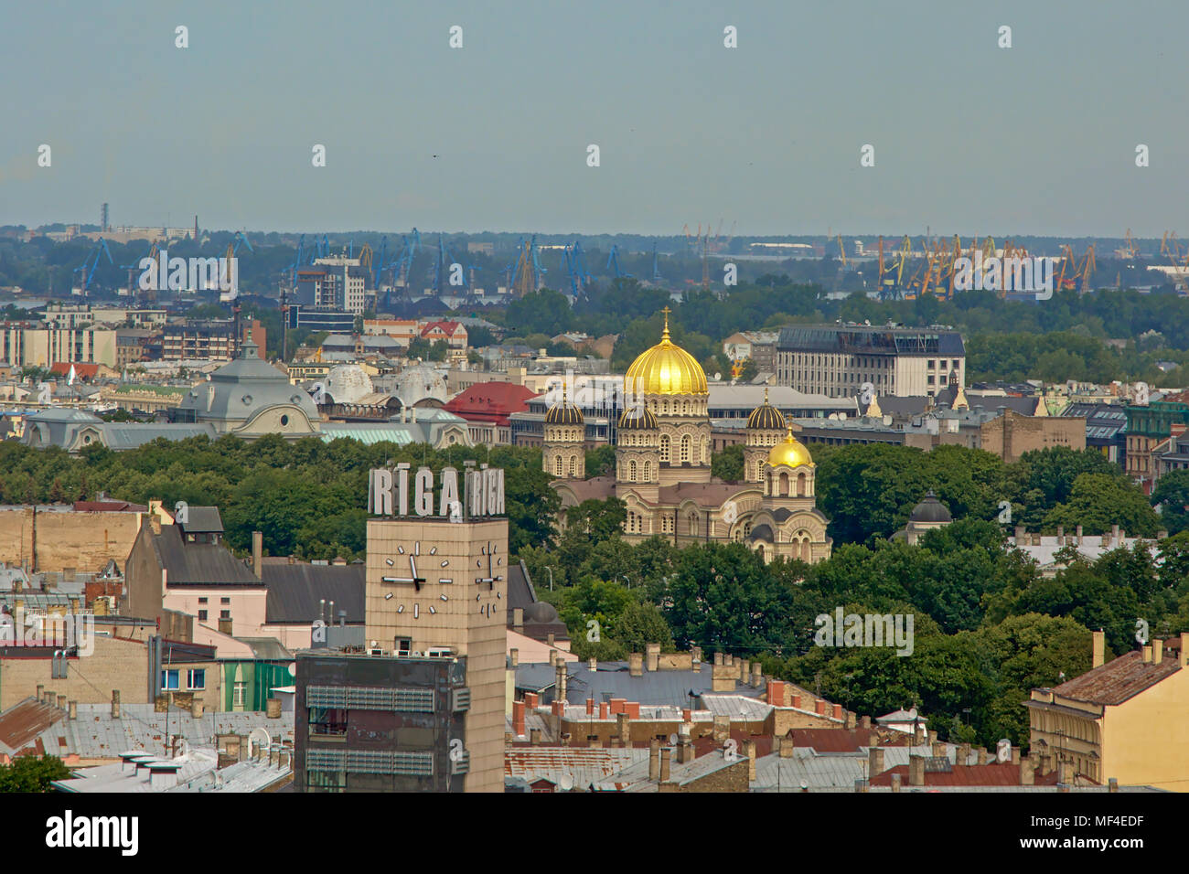 Aerial view on Riga, showing the golden cupola` of the Orthodox cathedral and railway station clock tower - Stock Image