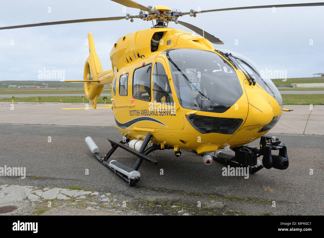 Scottish Ambulane Service helicopter on the apron at Sumburgh Airport Shetland Stock Photo