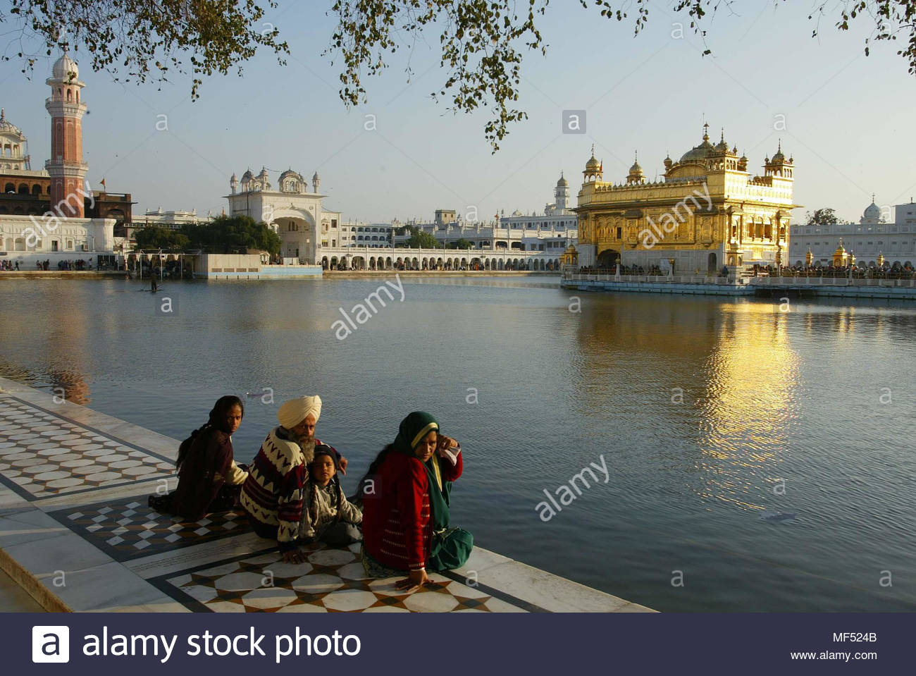File photo dated 01/02/04 of pilgrims at the edge of the moat surrounding the Golden Temple in Amritsar, India. The Foreign Office's top official has apologised after calling the revered Sikh temple a mosque. - Stock Image