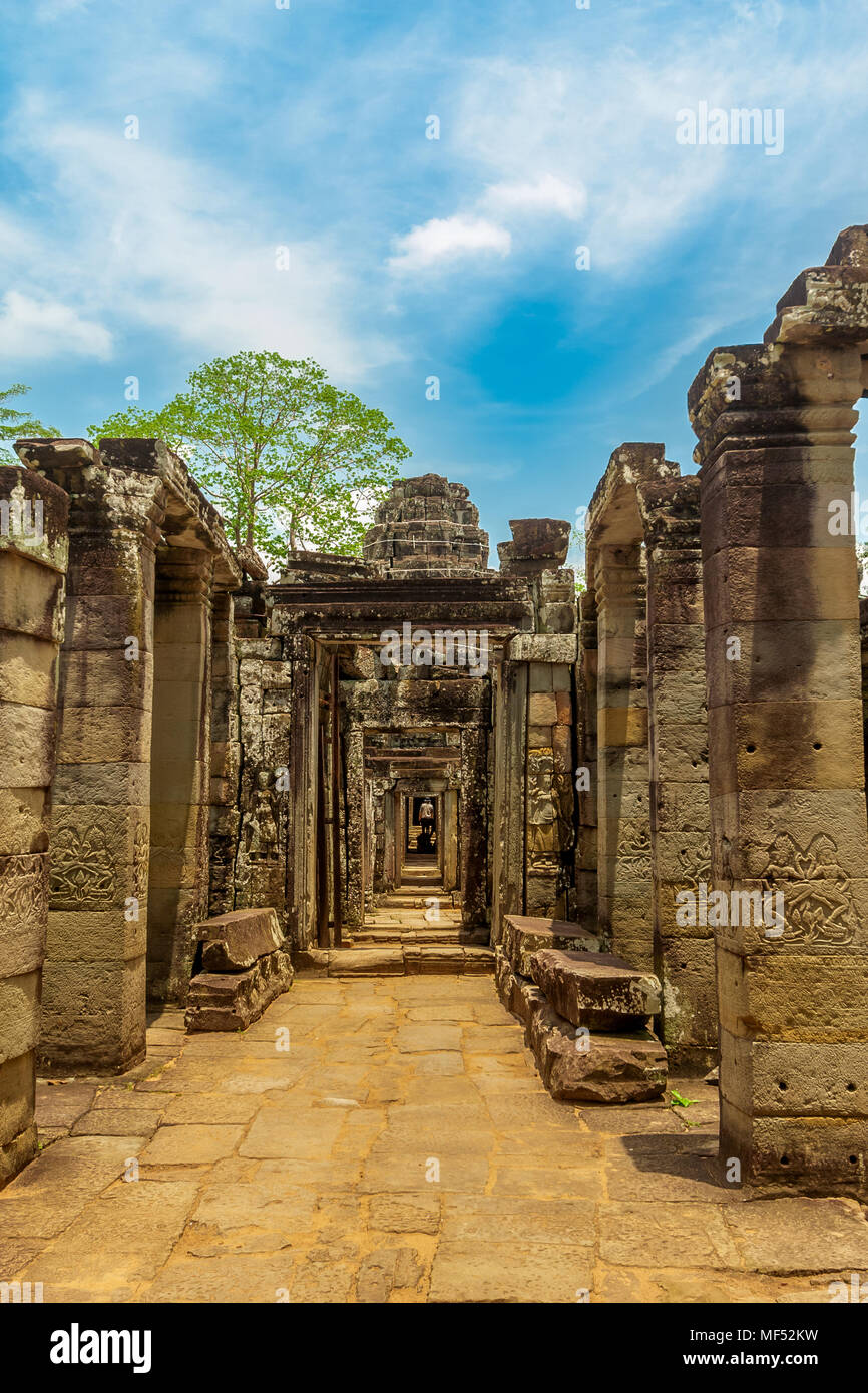 Corridor ruins with beautiful carved columns, leading to the inner circle of the Banteay Kdei temple in Angkor, Cambodia. - Stock Image