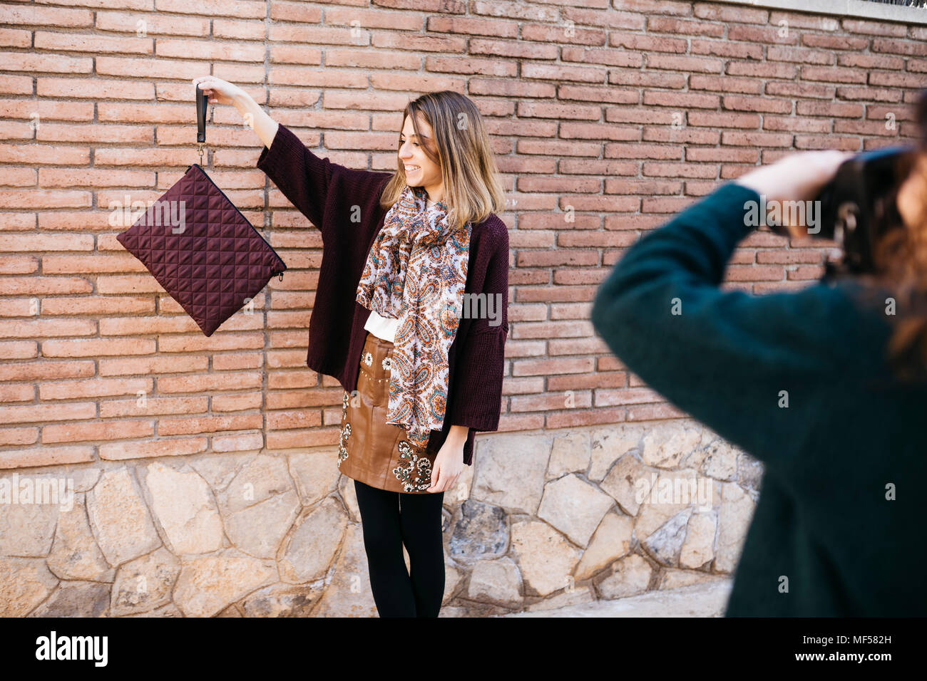 Fashion designers doing a photo shoot of their new products - Stock Image