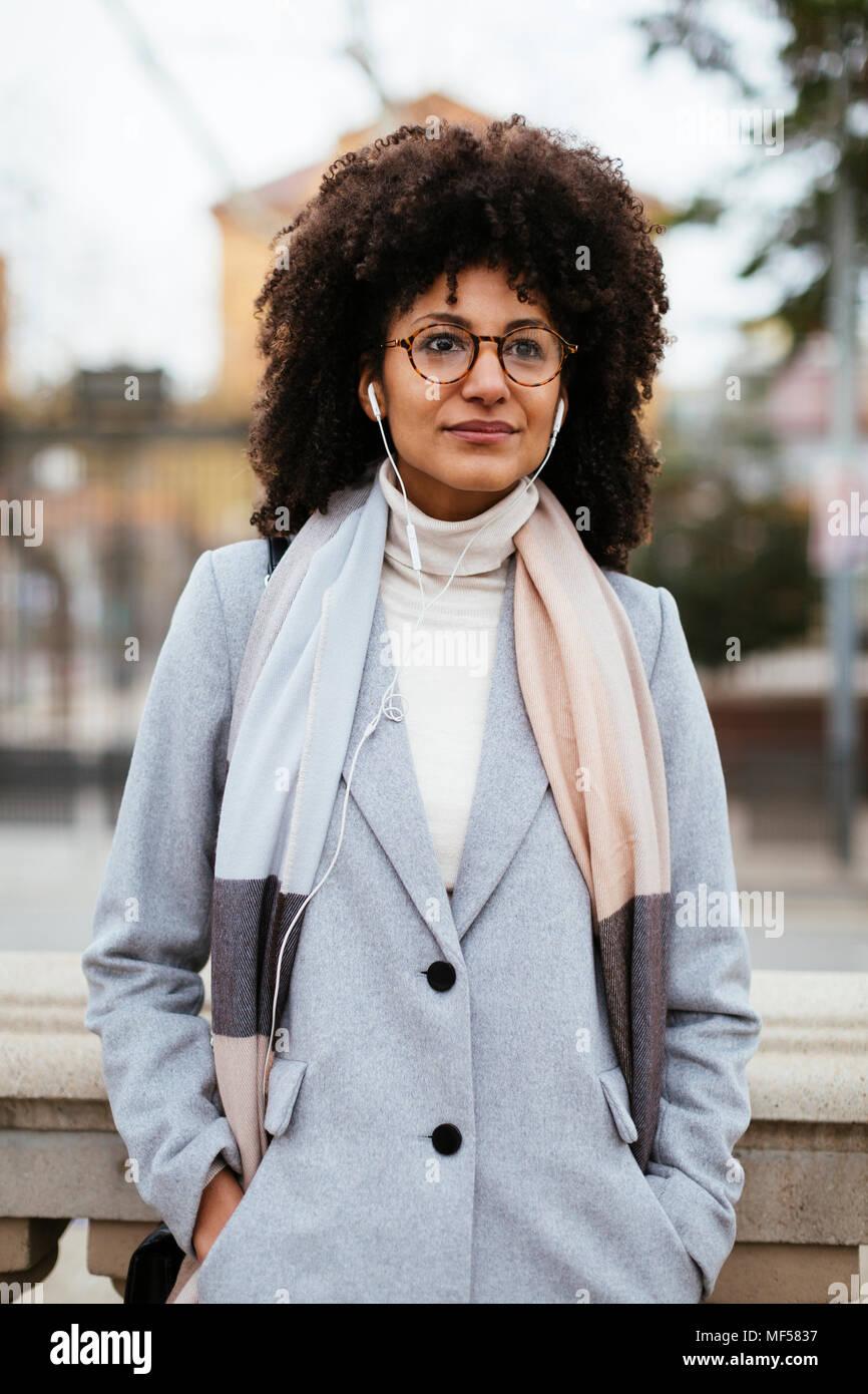 Portrait of woman with earphones - Stock Image