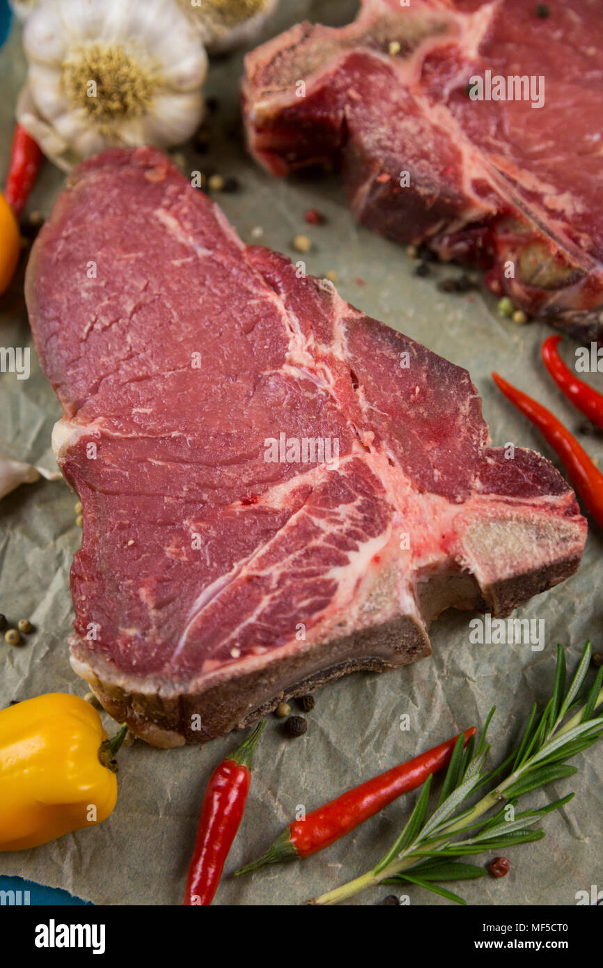 Raw dry-aged T-bone steak Stock Photo