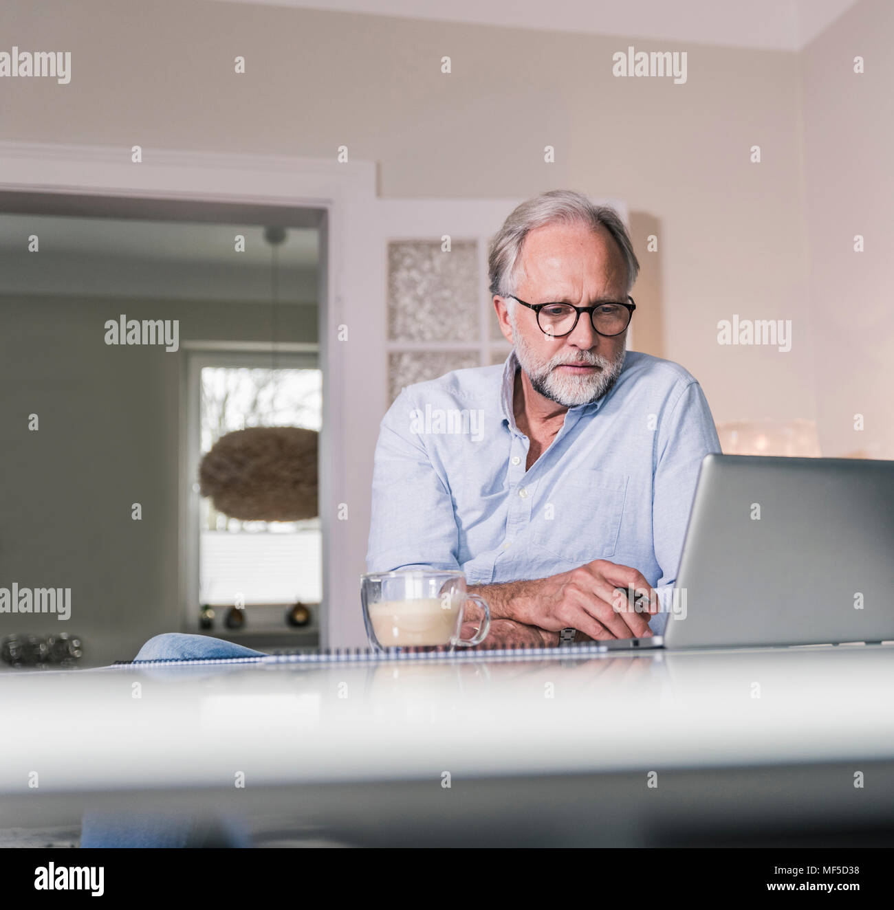 Portrait of businessman working at home office - Stock Image