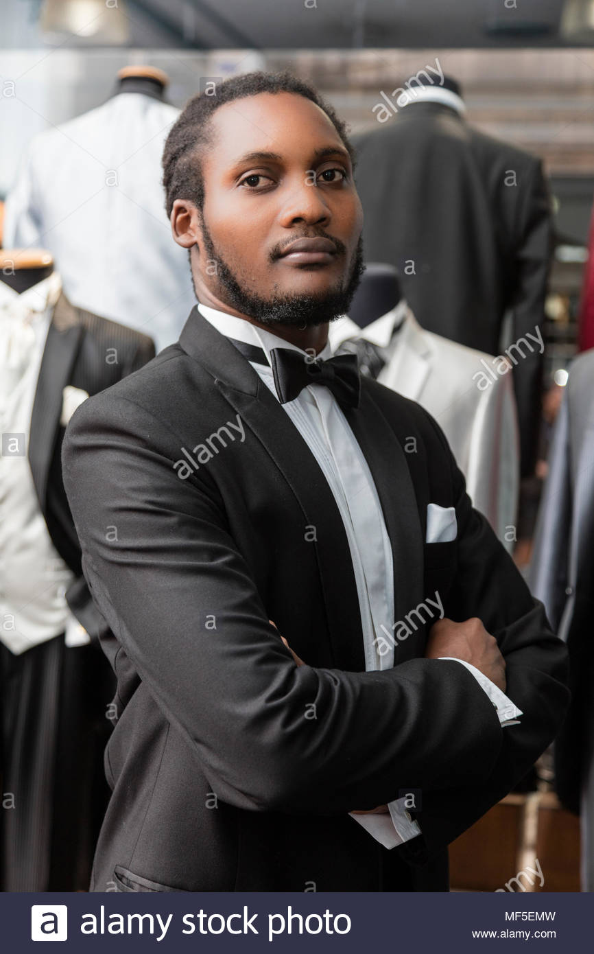 Portrait of a man wearing tuxedo in tailor shop - Stock Image