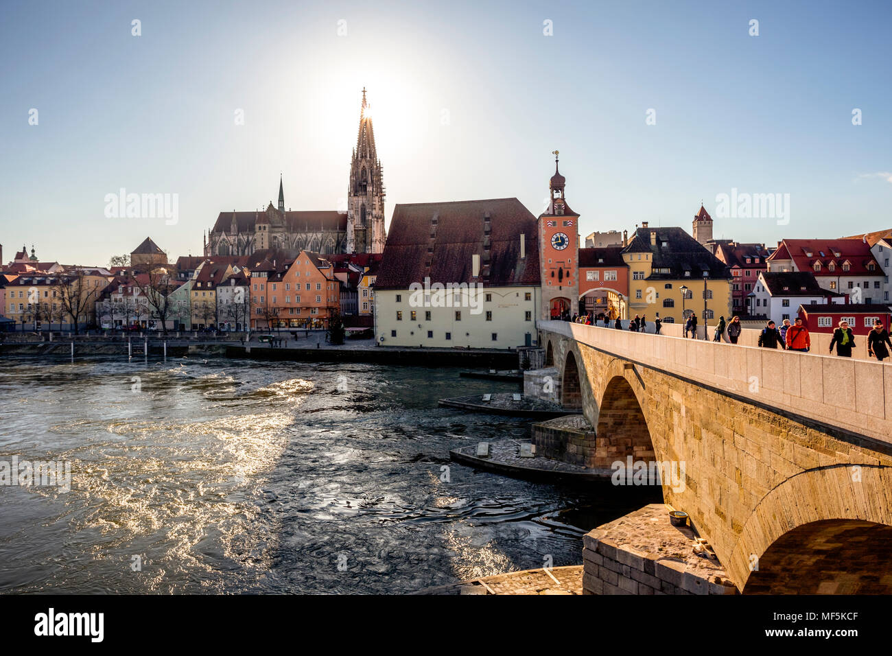 Germany, Regensburg, view to cathedral at the old town with Steinerne Bruecke over Danube river - Stock Image