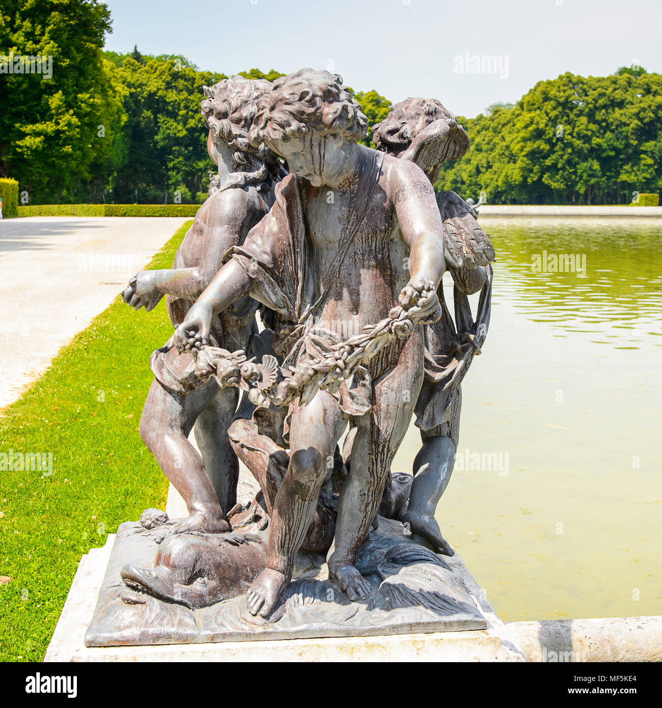 Statue of the fountain in front of the Herrenchiemsee Palace  , one of the most famous castles and the largest of King Ludwig II. - Stock Image