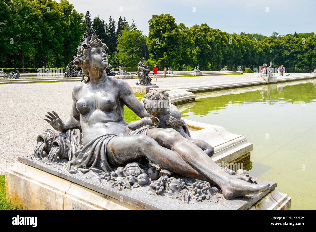 Statue of the fountain in front of the Herrenchiemsee Palace  , one of the most famous castles and the largest of King Ludwig II. Stock Photo