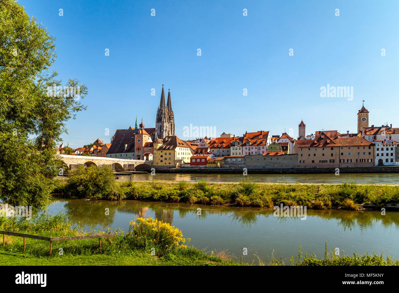 Germany, Regensburg, view of old town with cathedral and Danube River in the foreground - Stock Image