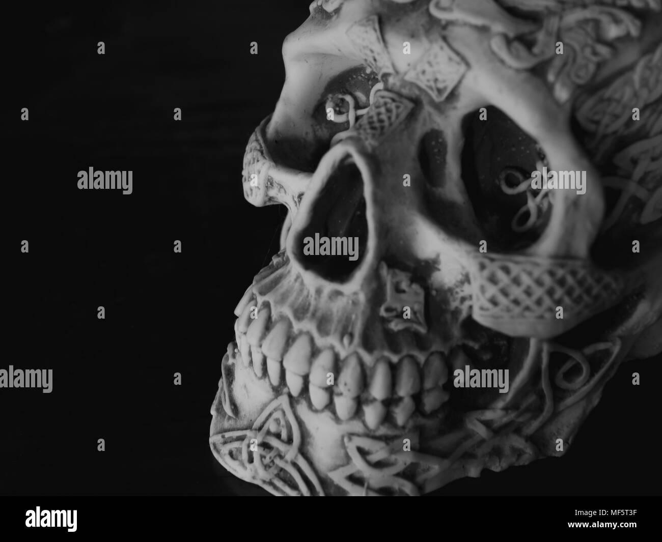 Human sugar skull on dark background horror concept stock photo