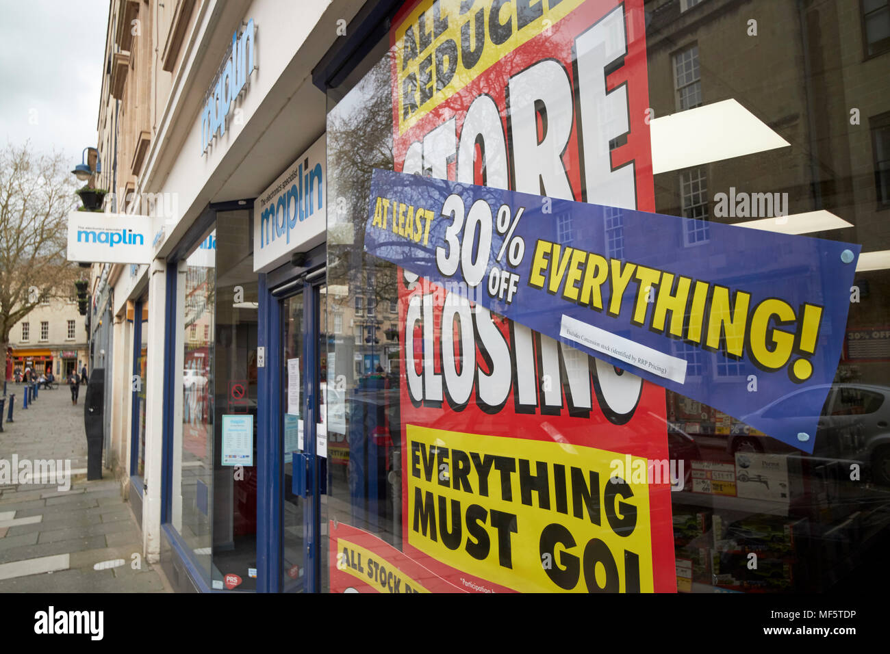 maplin shop store closing with reductions signs in the window Bath Somerset England UK - Stock Image