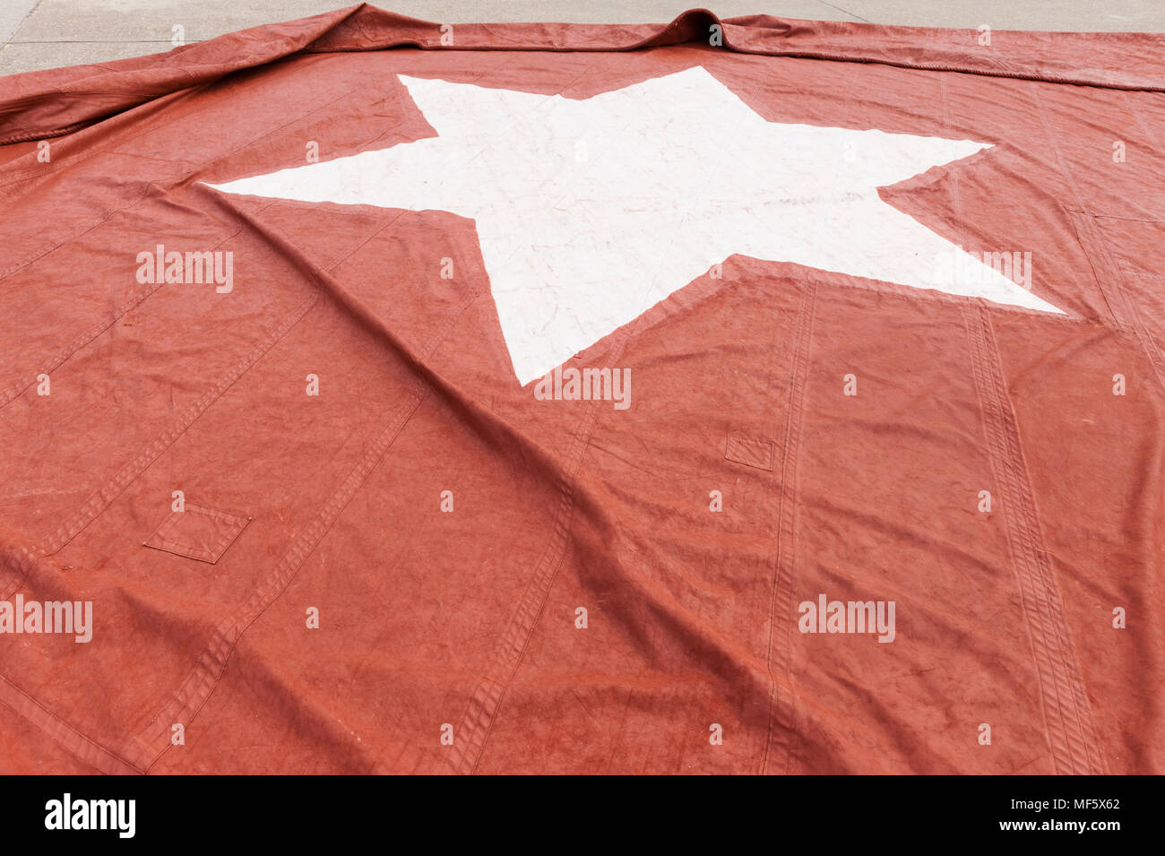 red thames barge sail laid out for painting - Stock Image