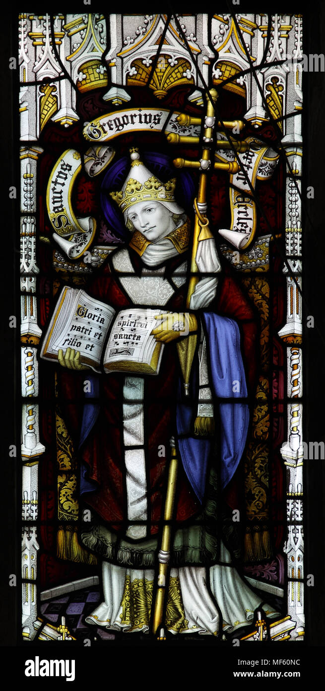 A stained glass window by Herbert Bryans (1855-1925) depicting St Gregory Doctor of the Church, St Andrews Church, Letheringsett, Norfolk - Stock Image
