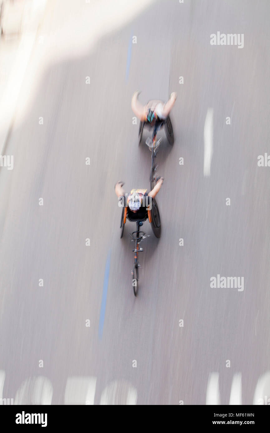 Two Para-Athletes compete at speed in their wheelchairs at the Marathon - April 22nd, 2018 London, UK Stock Photo