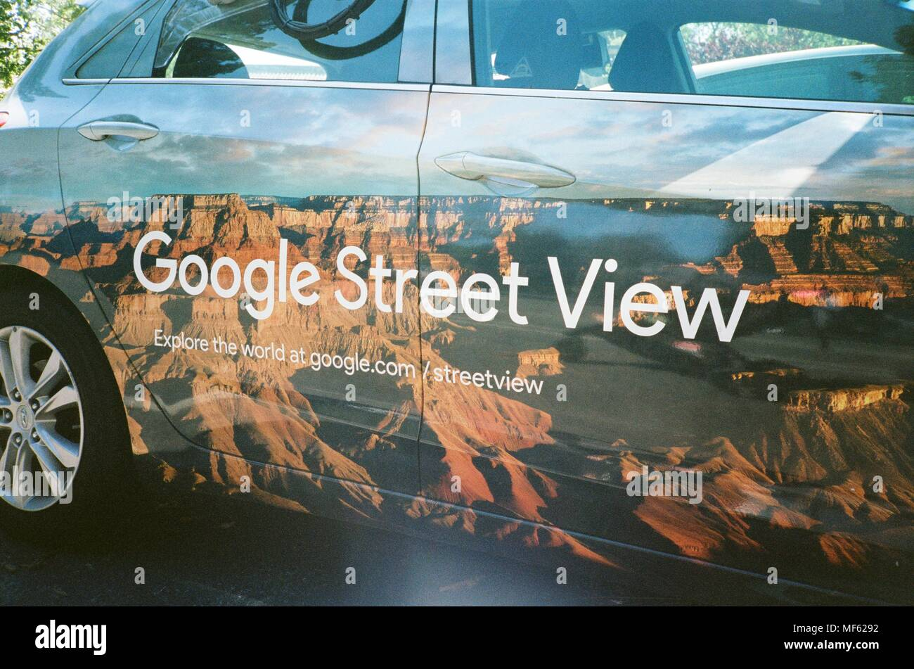 Google Street View vehicle with Street View logo parked at