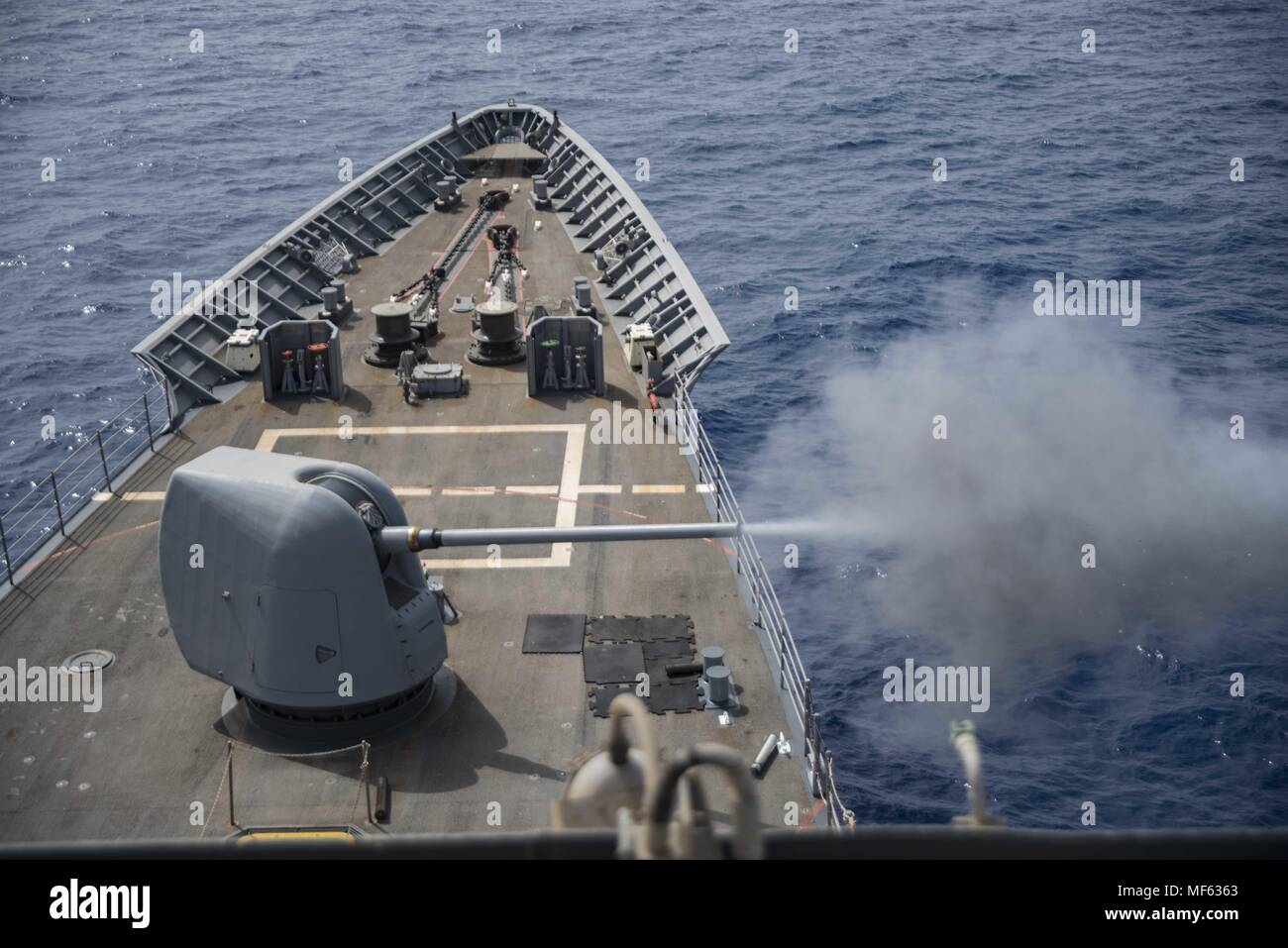 180419-N-DO281-0119 MEDITERRANEAN SEA (April 19, 2018) The guided-missile cruiser USS Monterey (CG 61) fires it's 5-inch gun during a live-fire exercise, April 19, 2018. Monterey, homeported in Norfolk, Va. and is conducting operations in the U.S. 6th Fleet area of operations in support of U.S. national security interest in Europe. (U.S. Navy photo by Mass Communication Specialist Seaman Trey Fowler/Released). () - Stock Image