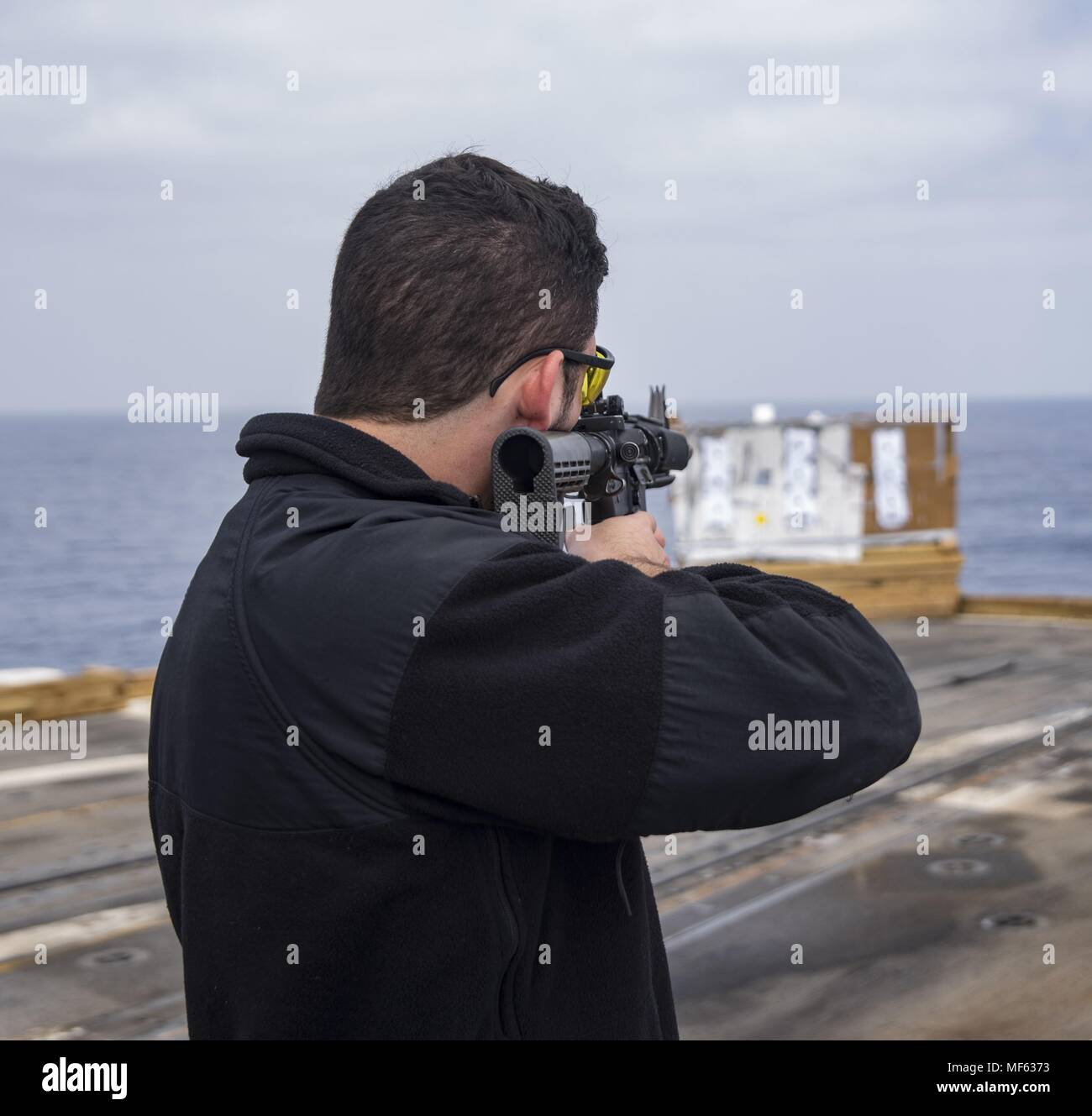 180418-N-DO281-0142 MEDITERRANEAN SEA (April 18, 2018) Quartermaster 3rd Class Colton Benham fires a M-16 rifle during a live-fire exercise aboard the guided-missile cruiser USS Monterey (CG 61), April 18, 2018. Monterey, home-ported in Norfolk, Virginia, is conducting operations in the U.S. 6th Fleet area of operations in support of U.S. national security interest in Europe. (U.S. Navy photo by Mass Communication Specialist Seaman Trey Fowler). () Stock Photo