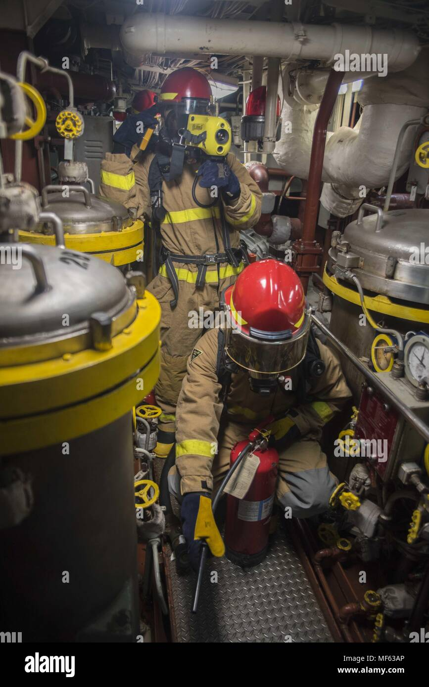 171031-N-DO281-117 ATLANTIC OCEAN (Oct. 31, 2017) Sailors respond to main engine room one during a main space fire drill aboard the guided-missile cruiser USS Monterey (CG 61), October 31, 2017. Monterey is deployed in support of maritime security operations in the U.S. 5th and 6th Fleet area of operations (U.S. Navy photo by Mass Communication Specialist Seaman Trey Fowler/Released). () Stock Photo