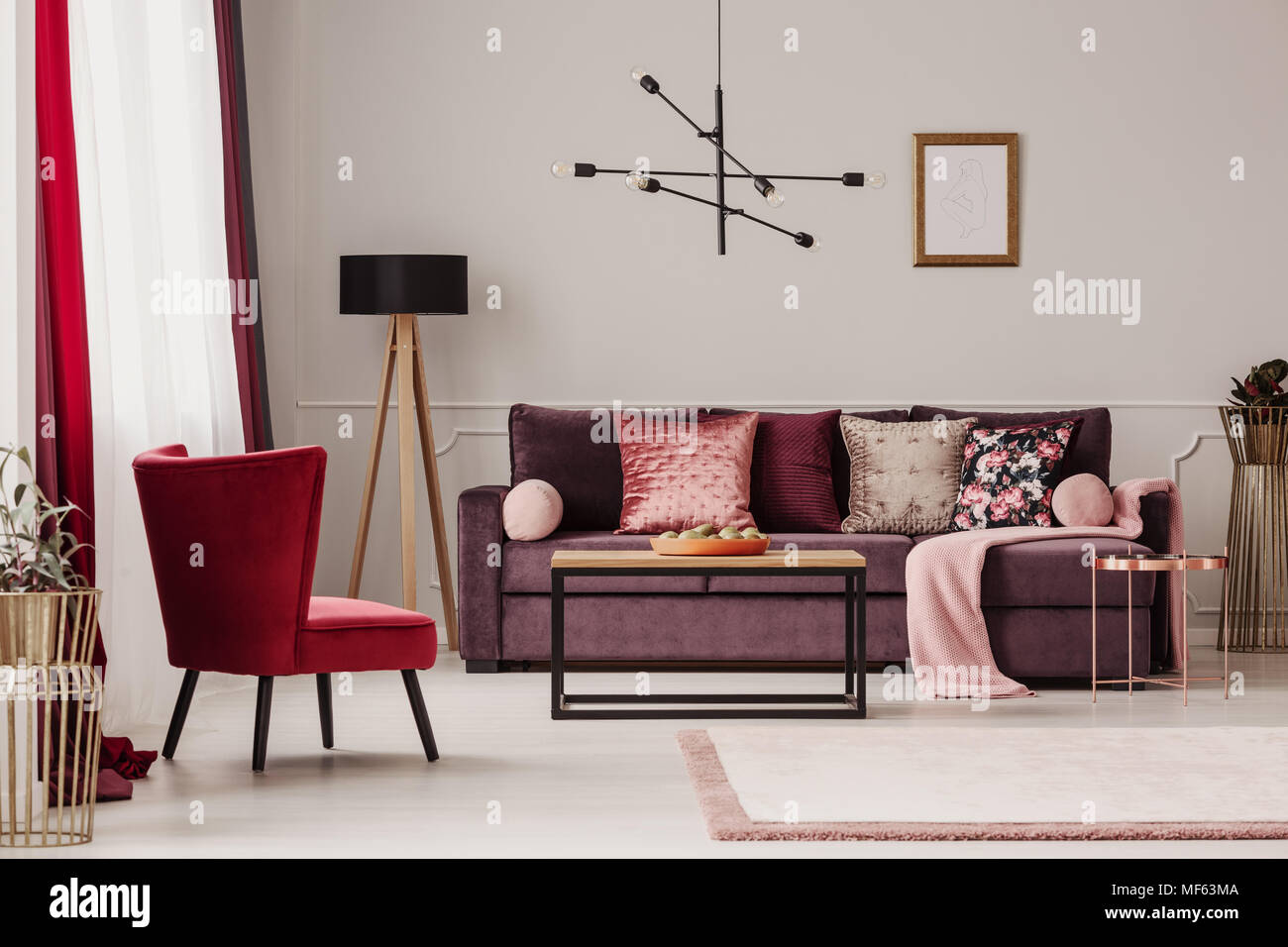 Enjoyable Red Armchair Near Wooden Table And Purple Sofa Against The Theyellowbook Wood Chair Design Ideas Theyellowbookinfo