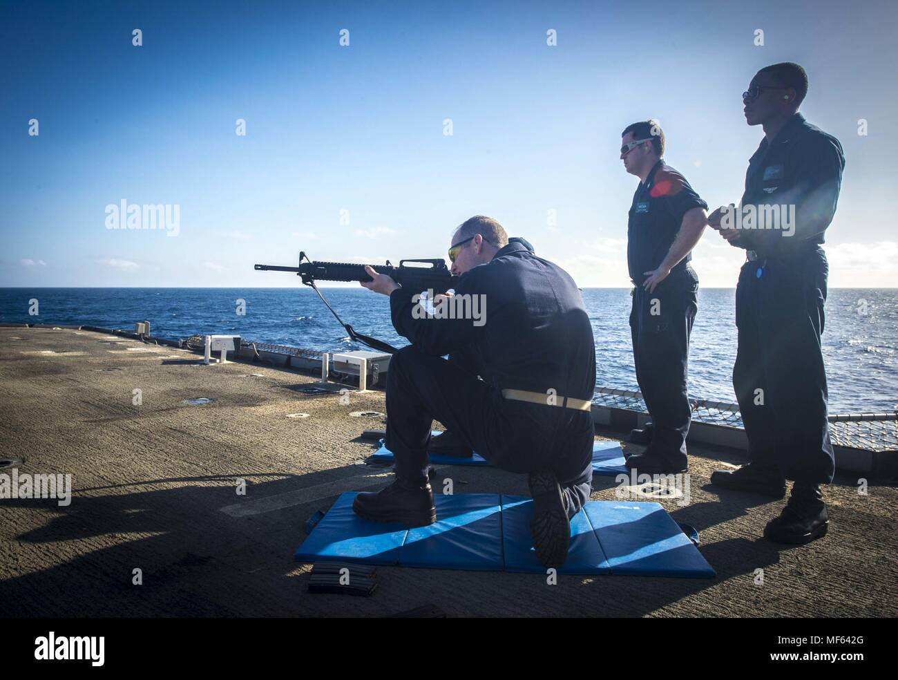 170109-N-BL607-145 ATLATIC OCEAN (Jan. 9, 2017) Sailors assigned to the guided-missile cruiser USS Monterey (CG 61) fire the M-16 rifle during a small arms qualification, January 9, 2017. Monterey, deployed as part of the Eisenhower Carrier Strike Group, is conducting naval operations in the U.S. 6th Fleet area of operations in support of U.S. national security interests in Europe. (U.S. Navy photo by Mass Communication Specialist 2nd Class William Jenkins). () Stock Photo