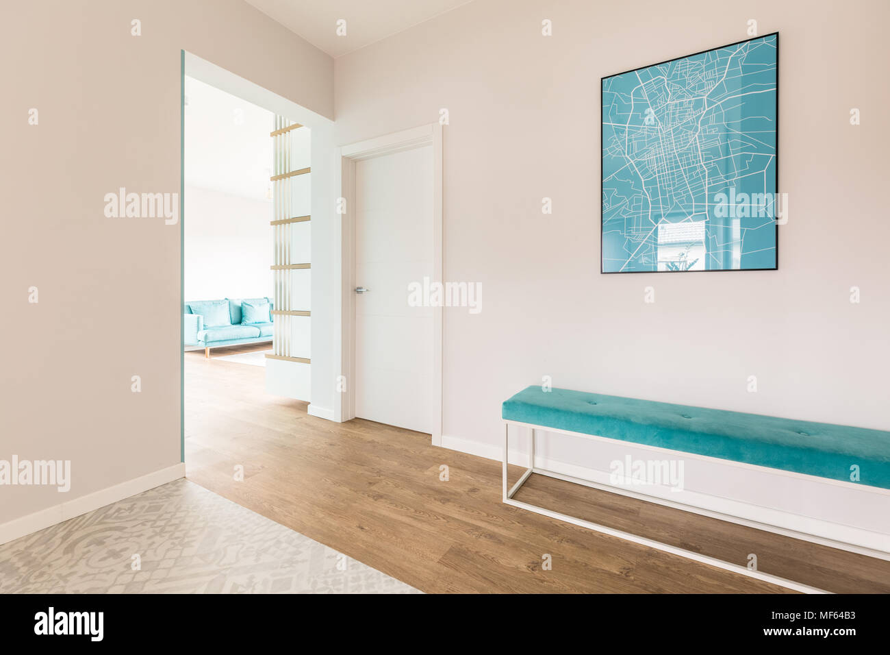 Simple hall with a blue map and bench and living room interior in ...