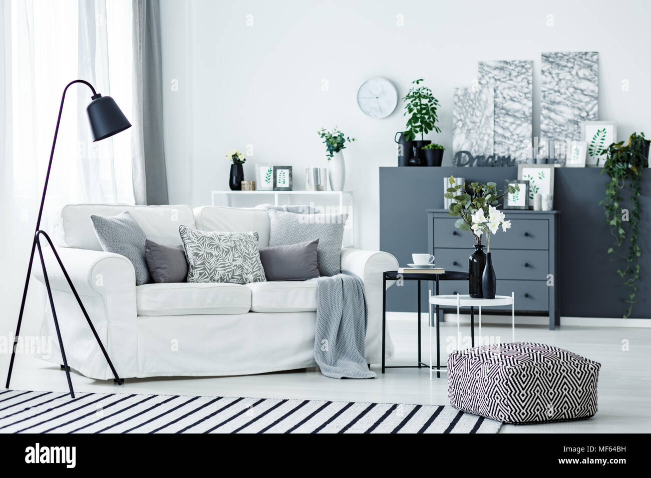 Nordic bright living room interior with white couch, fresh plants ...