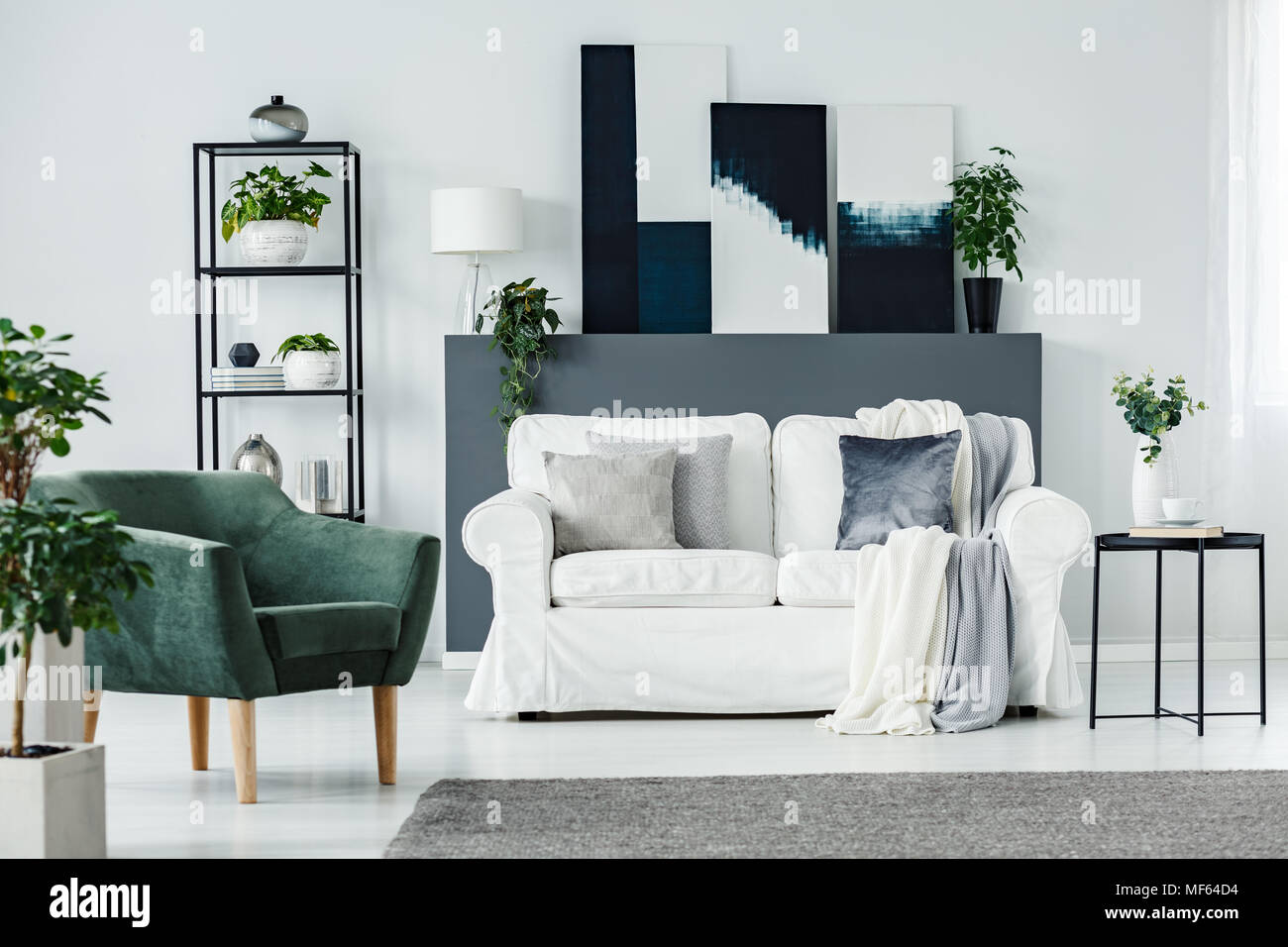 Simple Scandinavian Apartment Interior With White Sofa, Green Armchair,  Modern Paintings And Metal Furniture