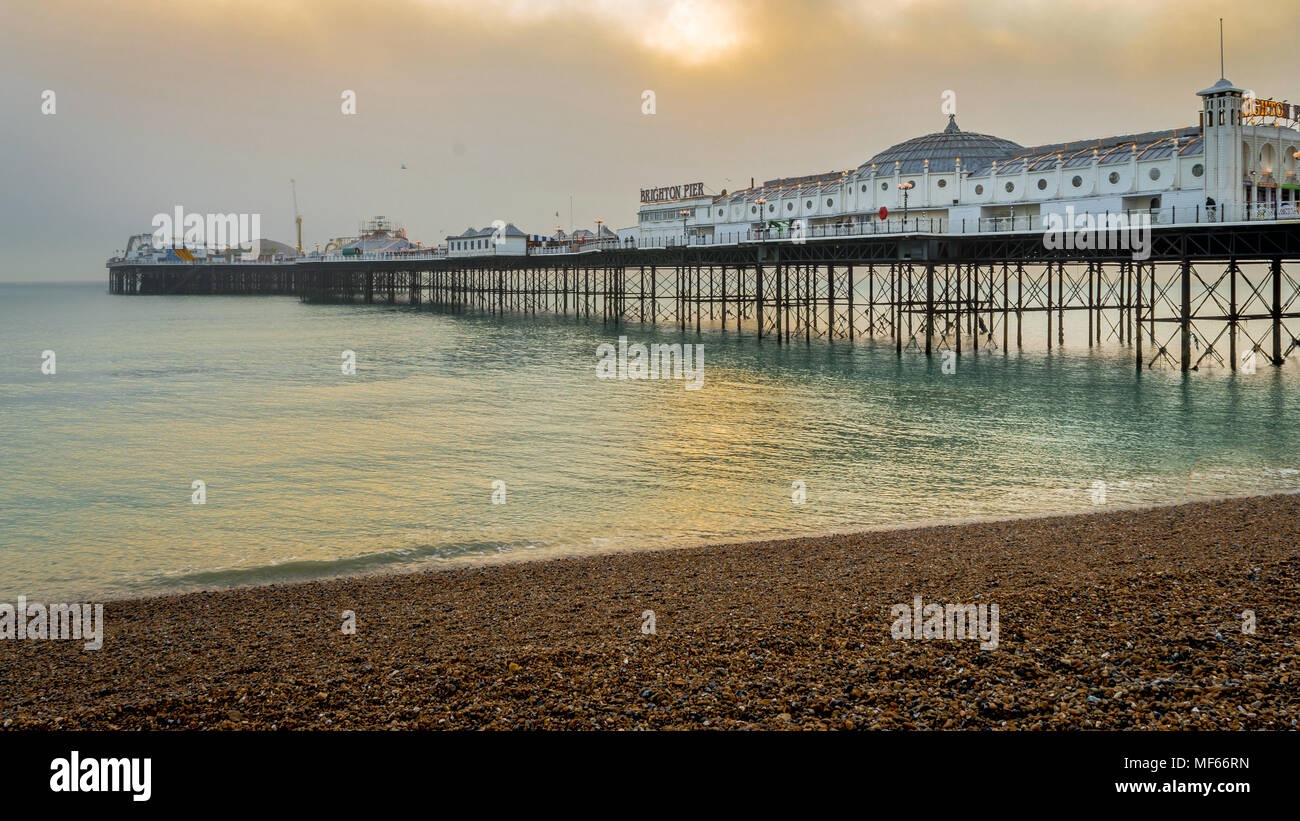 Brighton, Sussex, United Kingdom - 30 Dec, 2016 : A view of the Brighton Pier on a lovely winter evening just before sunset from the pebble beach - Stock Image