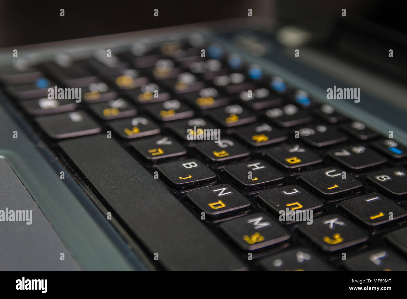 Keyboard with letters in Hebrew and English - Laptop keyboard - Close up - Stock Image