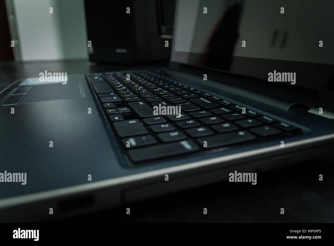 Keyboard with letters in Hebrew and English - Laptop keyboard - Dark atmosphere - Stock Image