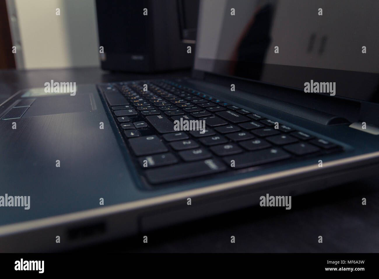 Keyboard with letters in Hebrew and English - Laptop keyboard - Stock Image