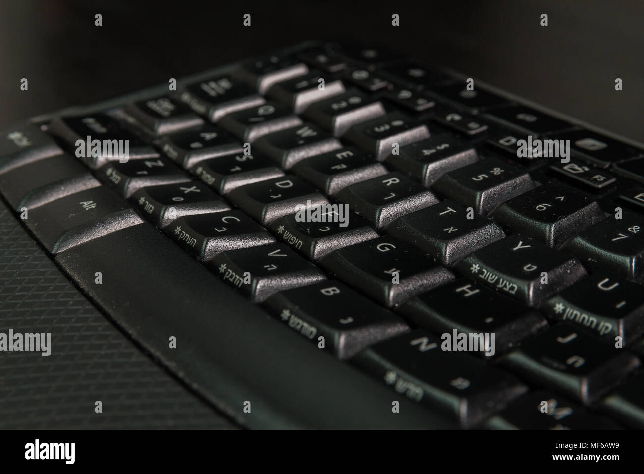 Keyboard with letters in Hebrew and English - Wireless keyboard - Close up - Stock Image