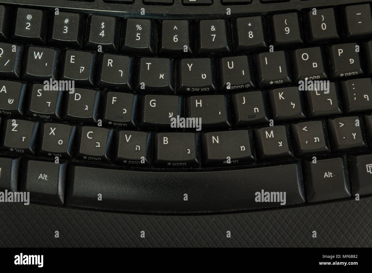 Keyboard with letters in Hebrew and English - Wireless keyboard - Top View - Stock Image