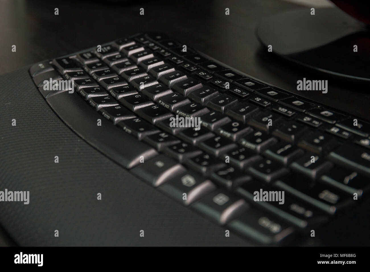 Keyboard with letters in Hebrew and English - Wireless keyboard - Stock Image