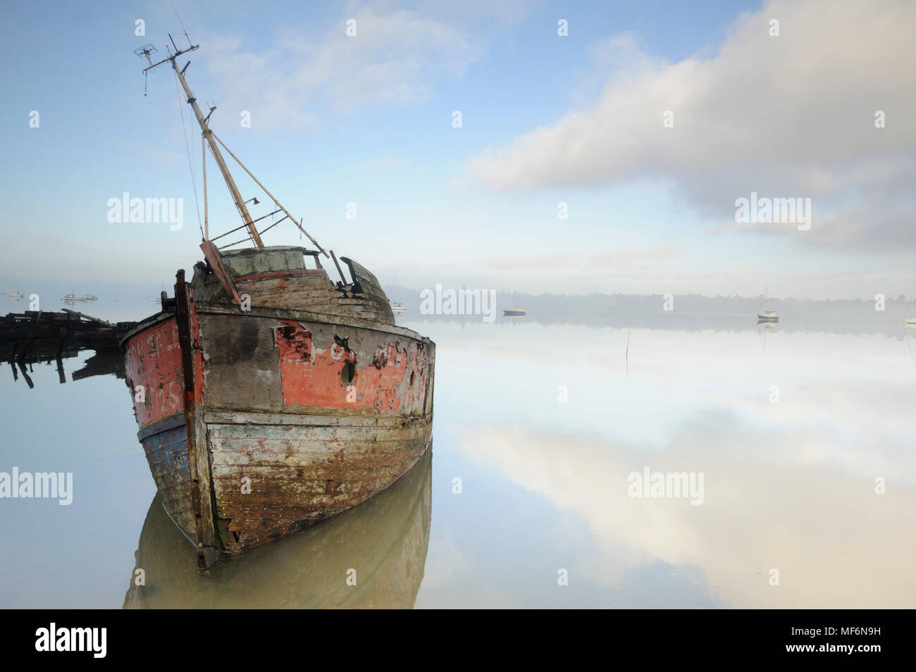Old Thames barge in rising mist - Stock Image