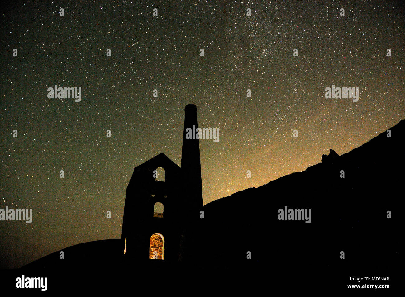 Abandoned Cornish Tin mine under starry night sky, August - Stock Image